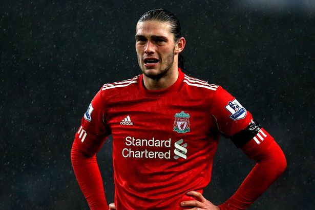 Andy Carroll of Liverpool looks dejected during the Barclays Premier League match between Manchester City and Liverpool at the Etihad Stadium